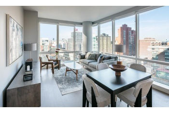 Two Bedroom In Lic With Floor To Ceiling Windows And Hardwood Flooring